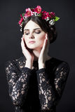 Beautiful woman with flower rim on head in lace dress Royalty Free Stock Image