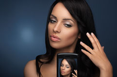 Beautiful black haired young woman Stock Photo