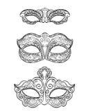Beautiful black lace masquerade mask isolated on white background. Ornate Stock Photos