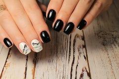 beautiful black manicure royalty free stock photography