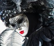 Beautiful black mask and costume at the Venice carnival Stock Photo
