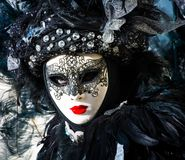 Beautiful black mask and costume at the Venice carnival Stock Photos