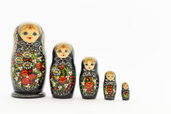 Beautiful black matryoshka dolls. Beautiful black russian nesting dolls & x28;matryoshka& x29; with white, green and red painting in front of white background Stock Images