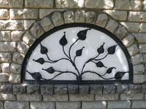 Home wall with metallic leaves in window, Lithuania Royalty Free Stock Photography