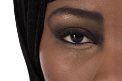 Beautiful black oriental colored woman: eyes and beauty. Royalty Free Stock Photo