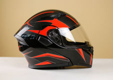 Beautiful black with red motorcycle helmet. With a transparent v Royalty Free Stock Image