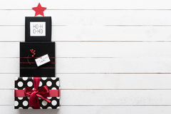 Beautiful black, red and white christmas presents, in a shape of a xmas tree. Elegant and beautiful black, red and white christmas presents, in a shape of a xmas Stock Images