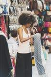 Beautiful black saleswoman stock image