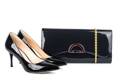 Beautiful black shoes with clutches on white  Royalty Free Stock Image