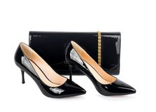 Beautiful black shoes with clutches Royalty Free Stock Photos