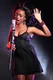 Beautiful black singer on stage with microphone Stock Photos