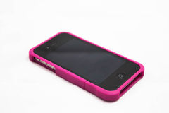 Beautiful black smartphone in pink case Royalty Free Stock Photo