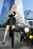 Beautiful black sport car city buildings young sex. Blond beautiful black sport car city buildings young girl royalty free stock photos