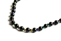Beautiful black string of beads Stock Images