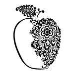 Beautiful black and white apple decorated with floral pattern. Stock Image