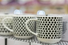 Beautiful black and white cups in a store.  royalty free stock photo