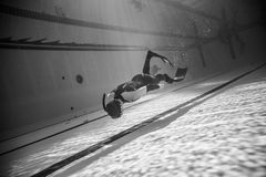 Beautiful Black and White image of Freediver doing Dynamic with Royalty Free Stock Photography