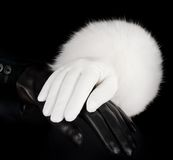Beautiful black and white leather women's gloves. On white Royalty Free Stock Photography