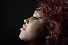 Beautiful black woman on black background. Studio shot stock photography