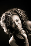 Beautiful black woman on black background. Studio shot Stock Image