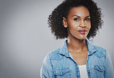 Beautiful black woman with blue jean shirt stock images