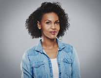 Beautiful black woman with blue jean shirt royalty free stock photography