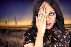 Beautiful black woman covering an eye Stock Image