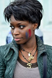 Beautiful black woman with french flag painted on her cheek Stock Photo