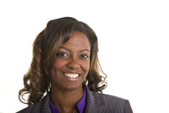 Beautiful Black Woman Great Eyes. A beautiful black woman in a purple blouse on white Royalty Free Stock Image