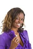 Beautiful Black Woman Hand on Collar. Beautiful Black woman in a purple blouse holding collar Stock Photos