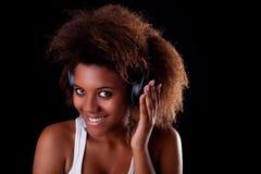 Beautiful black woman happy listening music royalty free stock image
