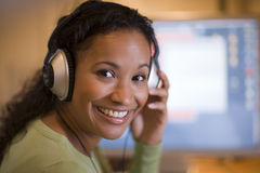 Beautiful black woman with headphones. Pretty smiling African American woman with headphones Royalty Free Stock Images