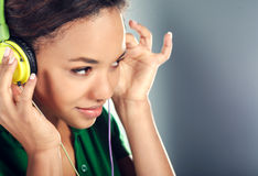 Beautiful black woman with headphones Stock Photography