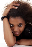 Beautiful black woman, holding her hair Stock Images