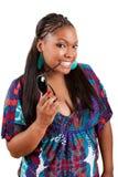 Beautiful black woman holding sunglasses stock photography