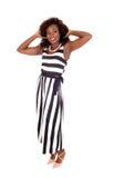 Beautiful black woman in jumpsuit. Stock Photo
