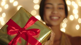 Beautiful black woman keeping big gift box in her hands and smiling stock footage