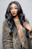 Beautiful black woman with long curly hair Stock Images