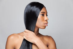 Beautiful black woman with long straight hair royalty free stock image