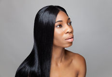 Beautiful black woman with long straight hair. Beautiful young black woman with long straight hair Royalty Free Stock Photography