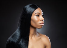 Beautiful black woman with long straight hair Royalty Free Stock Photography