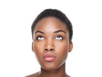 Beautiful black woman looking up. Beautiful young black woman looking up Royalty Free Stock Photos