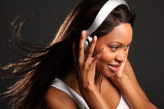 Beautiful black woman music lover listening Stock Photos