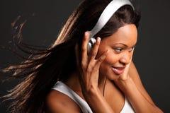 Beautiful black woman music lover listening Stock Photos