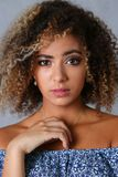 A beautiful black woman portrait. Tests the emotion of bewilderment of fear of terror confusion beauty fashion style mulatto curly hair with white locks eye Stock Image