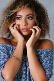 A beautiful black woman portrait. Tests the emotion of bewilderment of fear of terror confusion beauty fashion style mulatto curly hair with white locks eye Stock Photos