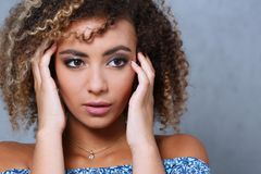 A beautiful black woman portrait. Tests the emotion of bewilderment. Of fear of terror confusion beauty fashion style mulatto curly hair with white locks eye Stock Images