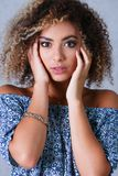 A beautiful black woman portrait. Tests the emotion of bewilderment. Of fear of terror confusion beauty fashion style mulatto curly hair with white locks eye Royalty Free Stock Image
