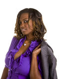 Beautiful Black Woman Purple Blouse. A beautiful black woman in purple blouse with a grey suit jacket over her shoulder Royalty Free Stock Photo