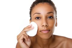 Beautiful black woman removing make up Stock Images